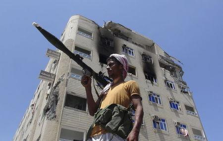 A Southern Popular Resistance fighter secures a street during fighting against Houthi fighters in the Dar Saad district of Yemen's southern port city of Aden May 9, 2015. REUTERS/Stringer