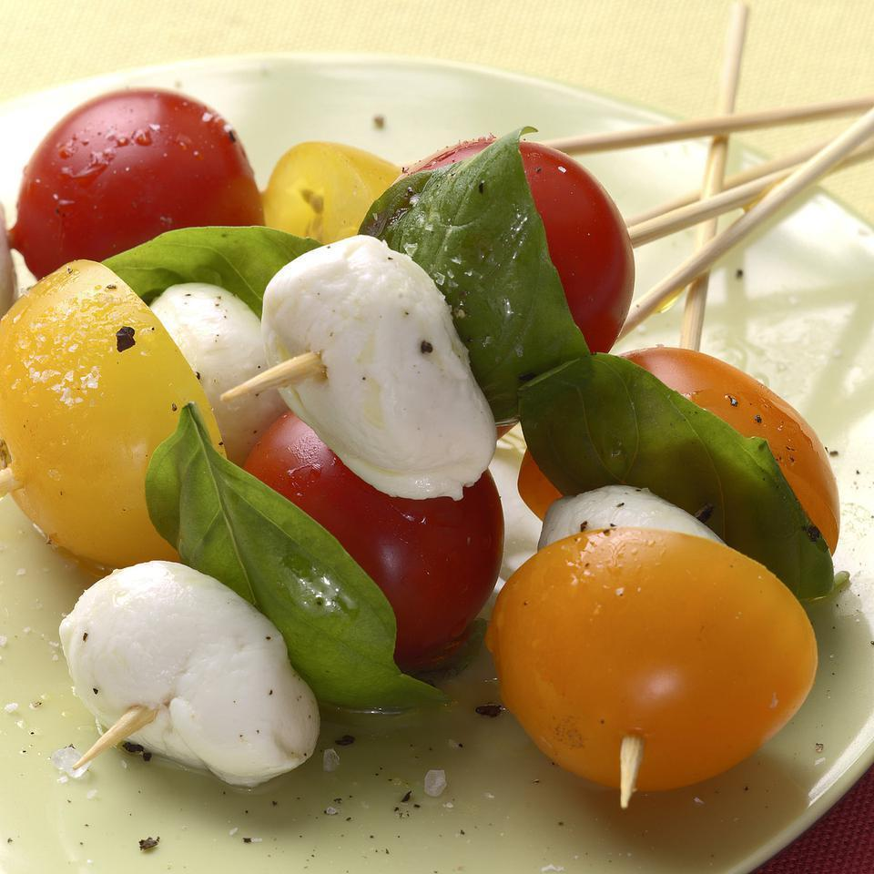 <p>Skewering mozzarella balls and cherry tomatoes makes them easy to nosh at a party.</p>