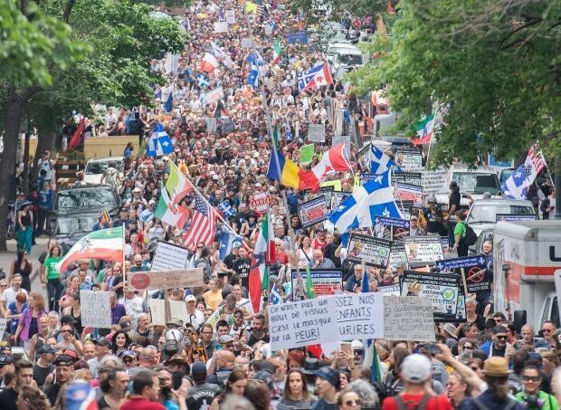 People take part in a demonstration opposing measures put in place to help curb the spread of COVID-19 in Montreal, Saturday, June 5, 2021. (Graham Hughes/The Canadian Press - image credit)