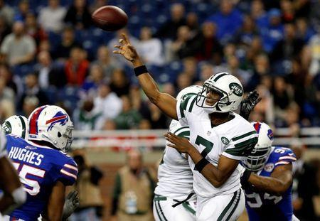 Nov 24, 2014; Detroit, MI, USA; New York Jets quarterback Geno Smith (7) throws a pass under pressure by Buffalo Bills defensive end Mario Williams (94) and defensive end Jerry Hughes (55) during the second half at Ford Field. Bills beat the Jets 38-3. Mandatory Credit: Kevin Hoffman-USA TODAY Sports