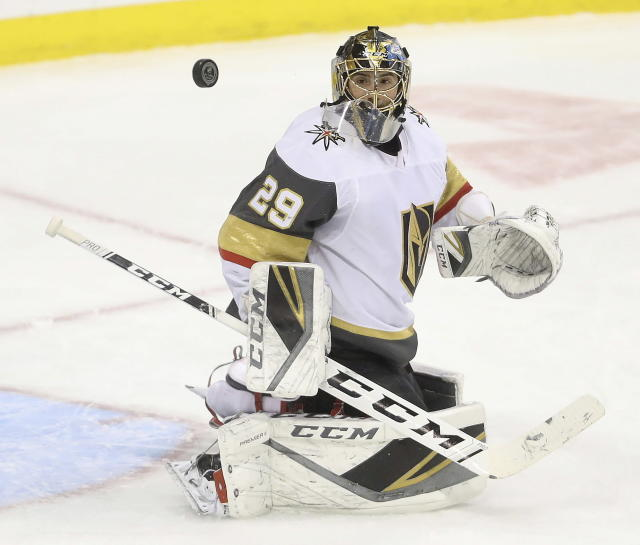 Vegas Golden Knights goaltender Marc-Andre Fleury watches a rebound during the first period of the team's NHL hockey game against the Winnipeg Jets on Tuesday, Jan. 15, 2019, in Winnipeg, Manitoba. (Trevor Hagan/The Canadian Press via AP)