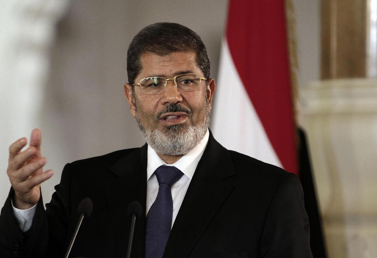 FILE - In this July 13, 2012 file photo, then Egyptian President Mohammed Morsi speaks to reporters at the presidential palace in Cairo. Egypt's state news agency says Morsi has arrived in Cairo for a trial over prison breaks in 2011. (AP Photo/Maya Alleruzzo, File)