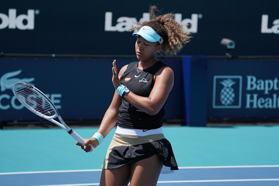 MIAMI GARDENS, FL - MARCH 26: Naomi Osaka (JPN) reacts during the second round match of the Miami Open on March 26, 2021, at Hard Rock Stadium in Miami Gardens, Florida. (Photo by Michele Eve Sandberg/Icon Sportswire via Getty Images)