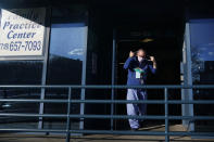 """Dr. Alan Roth walks to his office after an interview at Jamaica Hospital Medical Center in New York, Tuesday, Dec. 29, 2020. Dozens of clinics have cropped up around the U.S. to address a puzzling and troubling aspect of COVID-19 — the after-effects that can stubbornly afflict some people weeks or months after the infection itself has subsided. """"We know this is real,"""" said Roth, who oversees the Jamaica Hospital clinic. He has been grappling with body pain, fatigue and """"brain fog"""" characterized by occasional forgetfulness since his own relatively mild bout with COVID-19 in March. (AP Photo/Seth Wenig)"""