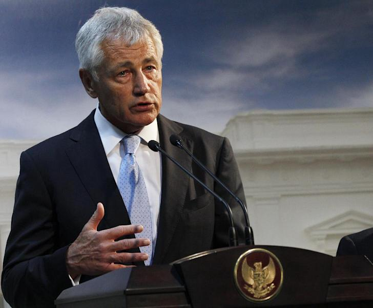 FILE - This Aug. 26, 2013 file photo shows Defense Secretary Chuck Hagel speaking in Jakarta, Indonesia. U.S. forces are now ready to act on any order by President Barack Obama to strike Syria, U.S. Hagel said Tuesday.The U.S. Navy has four destroyers in the eastern Mediterranean Sea positioned within range of targets inside Syria, as well as U.S. warplanes in the region, Hagel said in an interview with BBC television during his visit to the southeast Asian nation of Brunei. (AP Photo/Achmad Ibrahim, File)