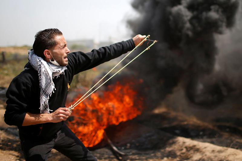 A Palestinian shoots a missile at Israeli troops in the border violence: Reuters