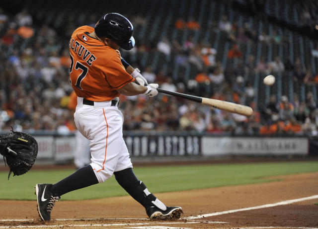 Houston Astros' Jose Altuve connects for a single against the Chicago White Sox in the first inning of a baseball game, Friday, June 14, 2013, in Houston. (AP Photo/Pat Sullivan)