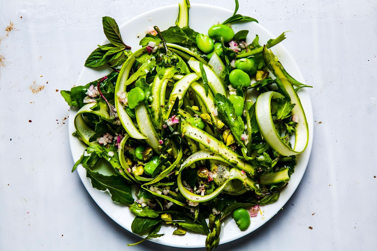 """Green beans! Green asparagus! Green pistachios! ... You get the idea—this salad is a celebration of spring. If you can't find fava beans, substitute English peas or sugar snap peas instead. <a href=""""https://www.bonappetit.com/recipe/fava-bean-asparagus-salad?mbid=synd_yahoo_rss"""">See recipe.</a>"""