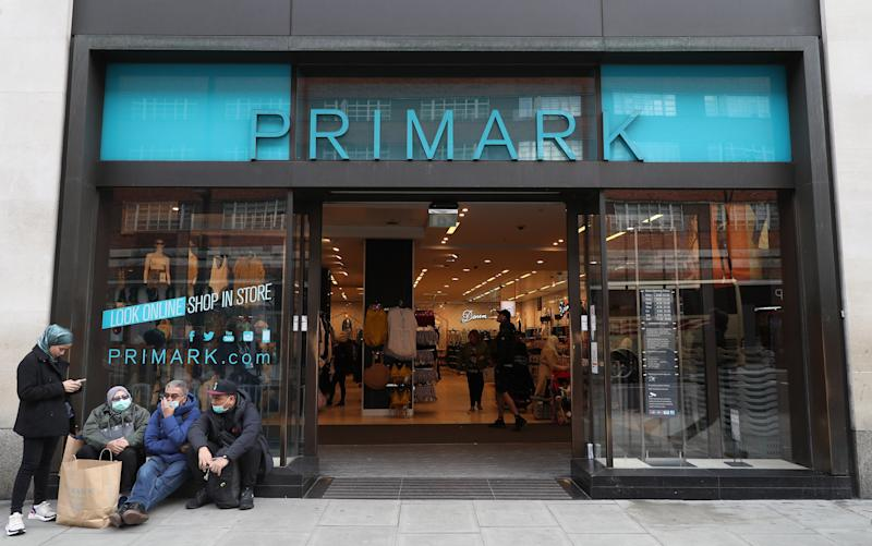 File photo dated 13/3/2020 of people in masks outside a Primark in Oxford Street in London. The owner of budget fashion firm Primark has said 68,000 staff have been furloughed across Europe amid the coronavirus lockdown as it revealed a �248 million hit for unsold stock as all its stores remain shut.