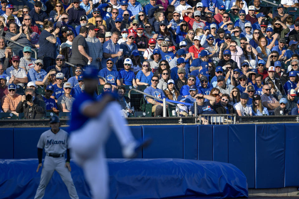 Fans watch Toronto Blue Jays starting pitcher Robbie Ray during the first inning of the team's baseball game against the Miami Marlins in Buffalo, N.Y., Tuesday, June 1, 2021. (AP Photo/Adrian Kraus)