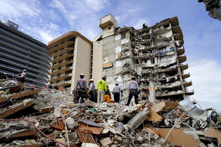 Search and rescue personnel work at the site of a collapsed Florida condominium complex in Surfside, Fla., on July 2, 2021. (Miami-Dade County Fire Department / via Reuters)