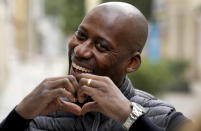 Joe Chialo, whose parents are from Tanzania, candidate of the German Christian Democratic Union, CDU, party for the federal elections, smiles during an interview with the Associated Press in his election district in Berlin, Germany, Sunday, Sept. 19, 2021. Hundreds of immigrants are running in Germany's national election on Sunday, raising the possibility of making its next parliament more diverse than ever. While it still might not fully represent the country's overall diversity, where more than a quarter of the population has immigrant roots, it's a step toward a more accurate reflection of society. (AP Photo/Michael Sohn)