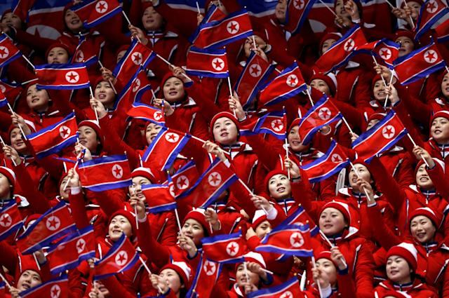 FILE PHOTO: Figure Skating Pyeongchang 2018 Winter Olympics Pair Skating free skating competition final Gangneung Ice Arena - Gangneung, South Korea February 15, 2018 - North Korean cheerleaders wave their national flags. REUTERS/Damir Sagolj/File Photo