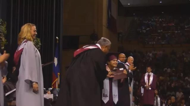 Carlos Neira enthusiastically accepts his high school diploma to a wave of cheers. (Photo: Facebook)