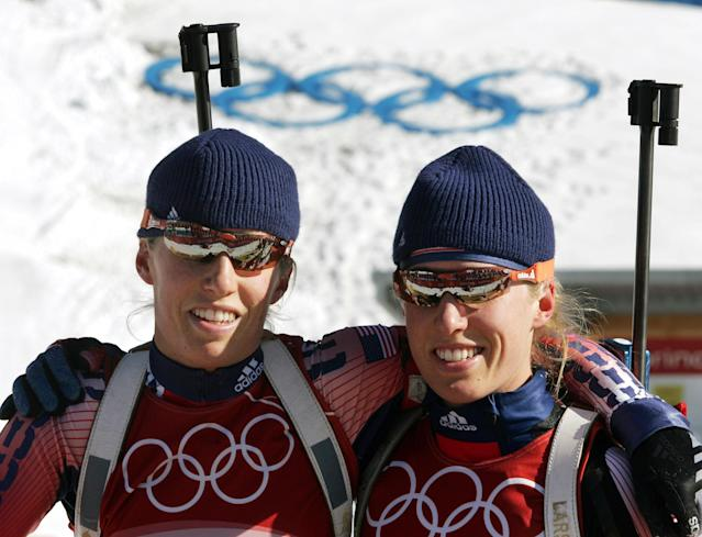 United States biathlete twins Lanny, right, and Tracy Barnes pose on the shooting range during a training session on the biathlon course in Cesana San Sicario, Italy, at the Turin 2006 Winter Olympic Games, Sunday, Feb. 12, 2006. (AP Photo/Michael Probst)