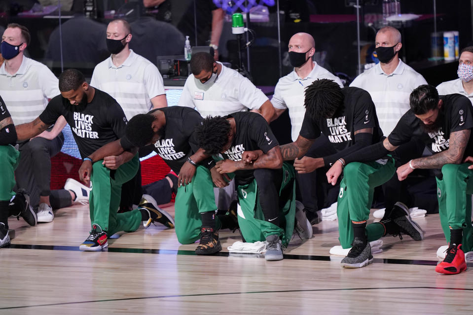 Boston Celtics kneel.