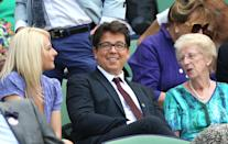 Michael and Kitty McIntyre in the royal box on centre court on day eleven of the Wimbledon Championships at the All England Lawn Tennis and Croquet Club, Wimbledon.