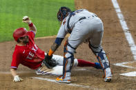 Texas Rangers' Nick Solak is tagged out by Houston Astros catcher Martin Maldonado during the fourth inning of a baseball game Friday, Aug. 27, 2021, in Arlington, Texas. (AP Photo/Sam Hodde)