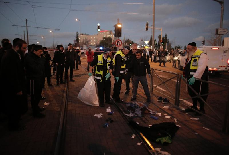 Israeli forensic police investigate the site of an attack near Jerusalem's light rail train service on January 4, 2016, after a Palestinian tried to stab security forces