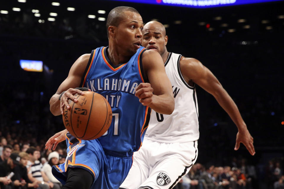 FILE - Oklahoma City Thunder guard Sebastian Telfair (31) dribbles past Brooklyn Nets guard Jarrett Jack (0) in the first half of an NBA basketball game in New York, in this Monday, Nov. 3, 2014, file photo. Eighteen former NBA players, including Telfair, have been charged with defrauding the leagues health and welfare benefit plan out of about $4 million, according to an indictment Thursday, Oct. 7, 2021. (AP Photo/John Minchillo, File)