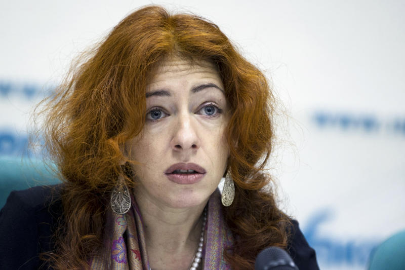 FILE - In this Jan. 29, 2015, file photo, program director and senior researcher at Human Rights Watch's Europe and Central Asia division Tanya Lokshina speaks at a news conference in Moscow, Russia. A smartphone app designed to track Moscow's quarantined coronavirus patients was rolled out by city officials in early April, but complaints about it have mushroomed, with people saying the app has glitches and wrongfully imposed fines on them. Lokshina said such apps are used in many countries, but she hasn't seen one that elicited such a huge amount of complaints. (AP Photo/Pavel Golovkin, File)