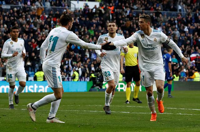 Soccer Football - La Liga Santander - Real Madrid vs Deportivo Alaves - Santiago Bernabeu, Madrid, Spain - February 24, 2018 Real Madrid's Cristiano Ronaldo celebrates scoring their first goal with Gareth Bale REUTERS/Juan Medina
