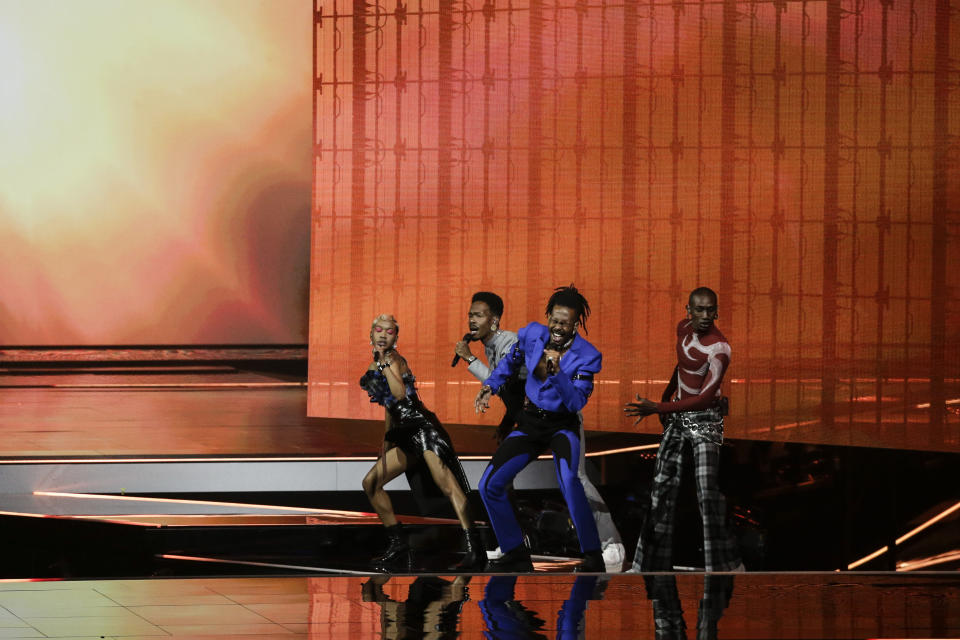 Jeangu Macrooy, centre, from the Netherlands performs during rehearsals at the Eurovision Song Contest at Ahoy arena in Rotterdam, Netherlands, Friday, May 21, 2021. (AP Photo/Peter Dejong)