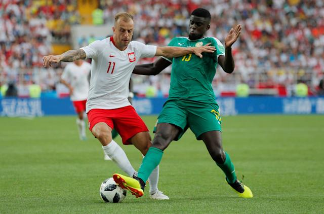 Soccer Football - World Cup - Group H - Poland vs Senegal - Spartak Stadium, Moscow, Russia - June 19, 2018 Poland's Kamil Grosicki in action with Senegal's Alfred N'Diaye REUTERS/Maxim Shemetov