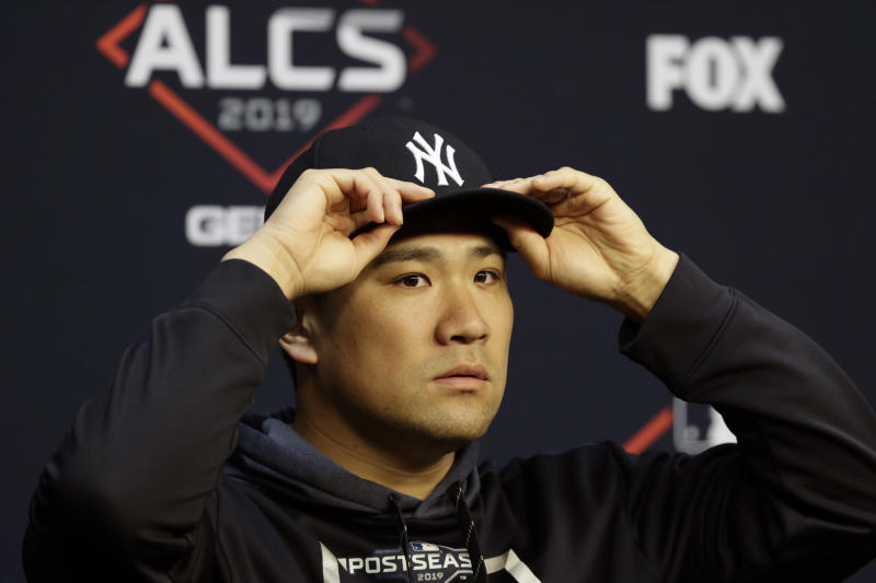 New York Yankees starting pitcher Masahiro Tanaka talks with the media during a news conference for a baseball American League Championship Series in Houston, Friday, Oct. 11, 2019. New York will face the Houston Astros, Saturday. (AP Photo/Eric Gay)