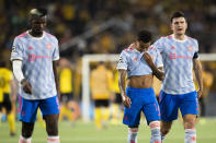 From left, Manchester United's Paul Pogba, Jesse Lingard and Harry Maguire leave the pitch after of the Champions League group F soccer match between BSC Young Boys and Manchester United, at the Wankdorf stadium in Bern, Switzerland, Tuesday, Sept. 14, 2021. (Peter Klaunzer/Keystone via AP)