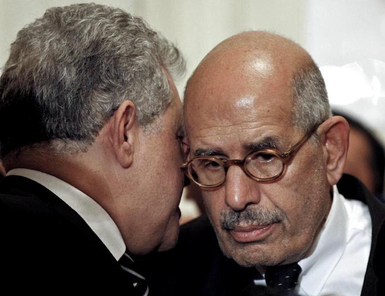 FILE - In this Thursday, Nov. 22, 2012 file photo, former Egyptian presidential candidate, Hamdeen Sabahi, left, speaks to former director of the U.N.'s nuclear agency and Nobel peace laureate, Mohamed El Baradei, during a news conference flanked by other prominent politicians, not shown, from outside the Muslim Brotherhood, to decry what was interpreted as a de facto declaration of emergency law by Egyptian President Mohammed Morsi, in Cairo Egypt. An Egyptian official says the country's top prosecutor has ordered an investigation into accusations against opposition leaders, Mohammed ElBaradei, Amr Moussa, and Hamdeen Sabahi, of incitement to overthrow the regime. (AP Photo/Mostafa El Shemy, File)