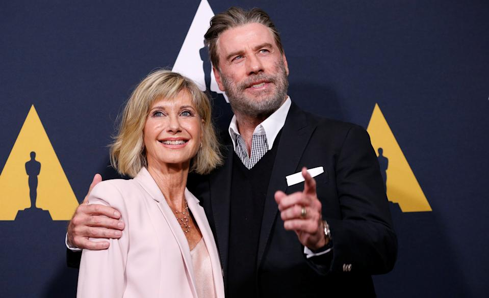 "Olivia Newton-John remains close friends with former costar John Travolta, both seen here at a 40th anniversary screening of ""Grease"" in 2018. ""I feel so strongly and so sad for the family,"" Newton-John says about the recent death of Travolta's wife, Kelly Preston. (Photo: REUTERS/Mario Anzuoni)"