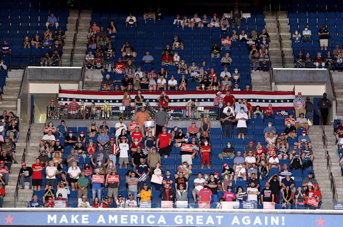 Supporters listen as President Trump speaks at a campaign rally at the BOK Center in Tulsa, Okla., Saturday. (Win McNamee/Getty Images)