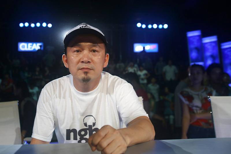 "In this photo taken Friday, Oct. 12, 2012, Vietnamese record producer Quoc Trung, who is leading a campaign against online piracy, sits after a ""Vietnam Idol 2012"" show in Ho Chi Minh City, Vietnam. The campaign is aimed at Zing.vn and other copyright violated websites. Zing.vn, one of globe's top 550 most visited websites, is a wildly popular website laden with unlicensed songs and Hollywood movies, a prime exhibit of the digital piracy that is strangling the music industry in Asia and eroding legitimate online sales around the world. (AP Photo/Na Son Nguyen)"
