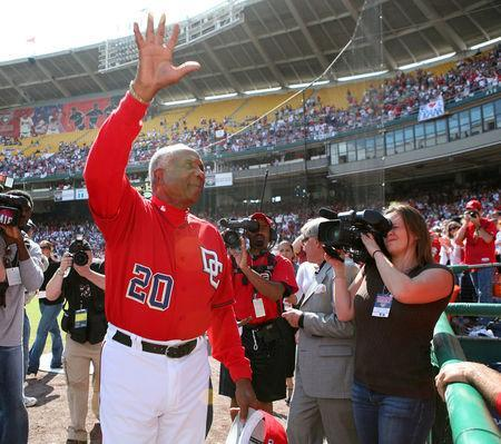 FILE PHOTO: Washington Nationals Manager Frank Robinson waves to the fans on his last day as the Nationals manager in Washington October 1, 2006. REUTERS/Joshua Roberts/File Photo