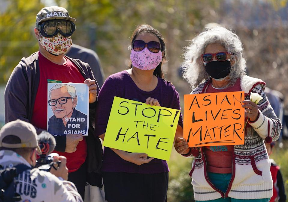 A man holds a portrait of Vichar Ratanapakdee, an 84-year-old immigrant from Thailand who was violently shoved to the ground in a deadly attack in San Francisco, during a rally to raise awareness of anti-Asian violence and racist attitudes, in Los Angeles on Feb. 20. The rally was in response to the string of violent racist attacks against Asians during the pandemic.
