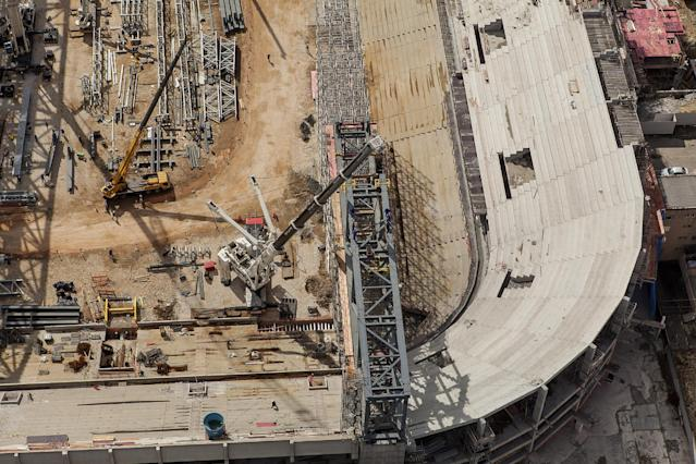 This Sept. 2013 photo released by Portal da Copa shows an aerial view of the Arena da Baixada stadium in Curitiba, Parana state, Brazil. During FIFA's latest inspection visit to the city, it was determined that the stadium will be completed without the retractable roof from the original design to avoid delaying the overall construction. Brazil is working at full steam to have all venues ready in time for the World Cup soccer tournament with less than three months to go before the December deadline established by FIFA for the delivery of the its stadiums. (AP Photo/Lucas Costa, Portal da Copa)