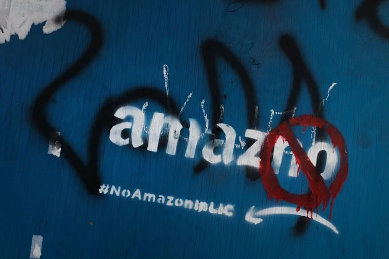 Anti-Amazon graffiti is seen in a Long Island City neighborhood initially selected for a new headquarters for the technology giant (AFP Photo/SPENCER PLATT)