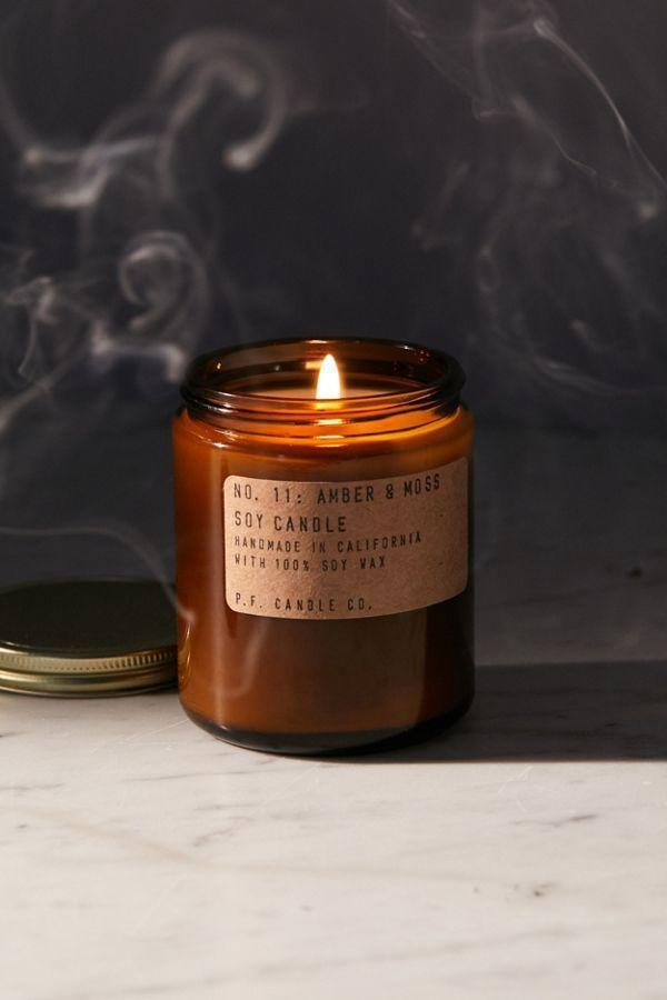 """<p><strong>P.F. Candle Co.</strong></p><p>urbanoutfitters.com</p><p><strong>$20.00</strong></p><p><a href=""""https://go.redirectingat.com?id=74968X1596630&url=https%3A%2F%2Fwww.urbanoutfitters.com%2Fshop%2Fpf-candle-co-amber-jar-soy-candle-001&sref=https%3A%2F%2Fwww.oprahmag.com%2Flife%2Fg27562264%2Fbest-fall-scented-candles%2F"""" rel=""""nofollow noopener"""" target=""""_blank"""" data-ylk=""""slk:SHOP NOW"""" class=""""link rapid-noclick-resp"""">SHOP NOW</a></p><p>A handcrafted <a href=""""https://www.oprahmag.com/life/g22591201/best-soy-candles/"""" rel=""""nofollow noopener"""" target=""""_blank"""" data-ylk=""""slk:soy candle"""" class=""""link rapid-noclick-resp"""">soy candle</a> with hints of amber and moss will keep you cozy and lasts for 40 hours of burn time. </p>"""