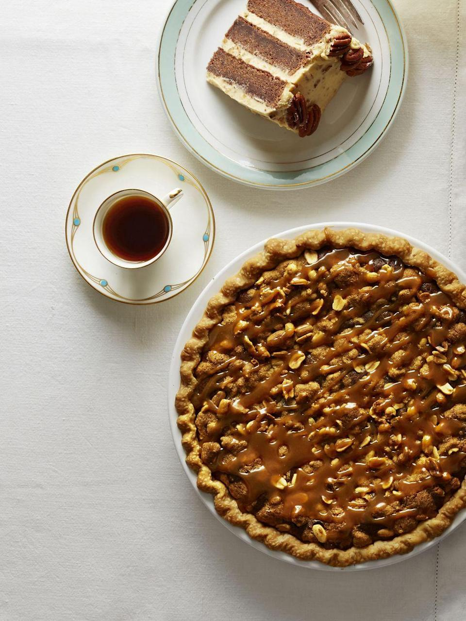 "<p>In every spoonful you'll taste this flavorful Thanksgiving pie's creamy peanut butter and chocolate filling.<br></p><p><strong><a href=""https://www.countryliving.com/food-drinks/recipes/a5906/salted-caramel-peanut-butter-fudge-pie-recipe-clx1114/"" rel=""nofollow noopener"" target=""_blank"" data-ylk=""slk:Get the recipe"" class=""link rapid-noclick-resp"">Get the recipe</a>.</strong></p><p><a class=""link rapid-noclick-resp"" href=""https://www.amazon.com/Camp-Chef-True-Seasoned-CIPIE10/dp/B000OXAQ6G?tag=syn-yahoo-20&ascsubtag=%5Bartid%7C10050.g.957%5Bsrc%7Cyahoo-us"" rel=""nofollow noopener"" target=""_blank"" data-ylk=""slk:SHOP PIE PANS"">SHOP PIE PANS</a> </p>"