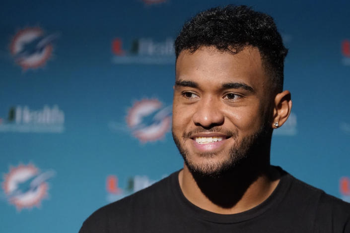 Miami Dolphins quarterback Tua Tagovailoa smiles during a news conference after a win over the New England Patriots in an NFL football game, Sunday, Sept. 12, 2021, in Foxborough, Mass. (AP Photo/Steven Senne)