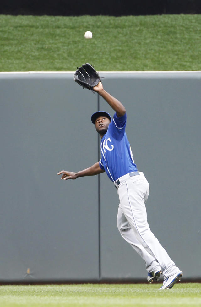Kansas City Royals center fielder Lorenzo Cain catches a fly to center by Minnesota Twins' Brian Dozier during the sixth inning of a baseball game in Minneapolis, Saturday, April 12, 2014. The Twins won 7-1.(AP Photo/Ann Heisenfelt)