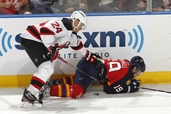 SUNRISE, FL - APRIL 21: Bryce Salvador #24 of the New Jersey Devils checks Scottie Upshall #19 of the Florida Panthers off the puck in Game Five of the Eastern Conference Quarterfinals during the 2012 NHL Stanley Cup Playoffs at the BankAtlantic Center on April 21, 2012  in Sunrise, Florida. The Panthers defeated the Devils 3-0. (Photo by Joel Auerbach/Getty Images)