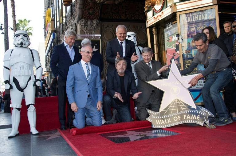 Harrison Ford (top L), George Lucas (top C), Mark Hamill (bottom C), and Hollywood Chamber of Commerce, President/CEO Leron Gubler (bottom R), and guests attend as Mark Hamill is honored with a star on the Hollywood Walk of Fame on March 8, 2018