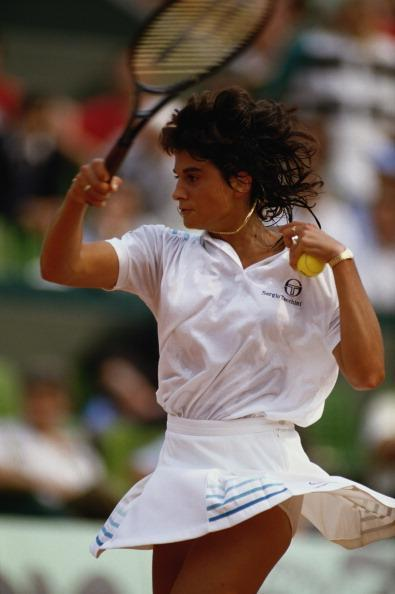 Gabriela Sabatini of Argentina makes a return against Steffi Graf during the Women's Sngles semi final match during the French Open Tennis Championship on 4th June 1987 at the Stade Roland Garros Stadium in Paris, France.
