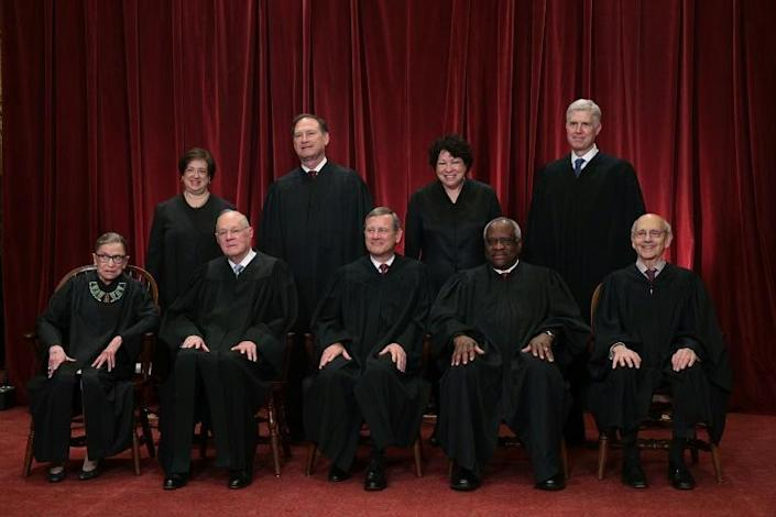 The current members of the US Supreme Court pose for a group photo with Justice Ruth Bader Ginsburg on the bottom left (AFP Photo/ALEX WONG)
