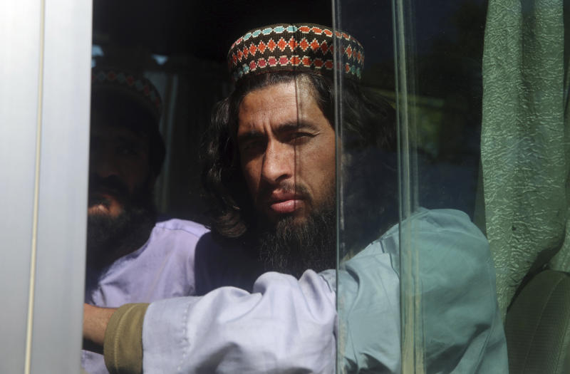 An Afghan Taliban prisoner rides a bus after his release from Bagram Prison in Parwan province, Afghanistan, Tuesday, May 26, 2020. The Afghan government freed hundreds of prisoners, its single largest prisoner release since the U.S. and the Taliban signed a peace deal earlier this year that spells out an exchange of detainees between the warring sides. (AP Photo/ Rahmat Gul)