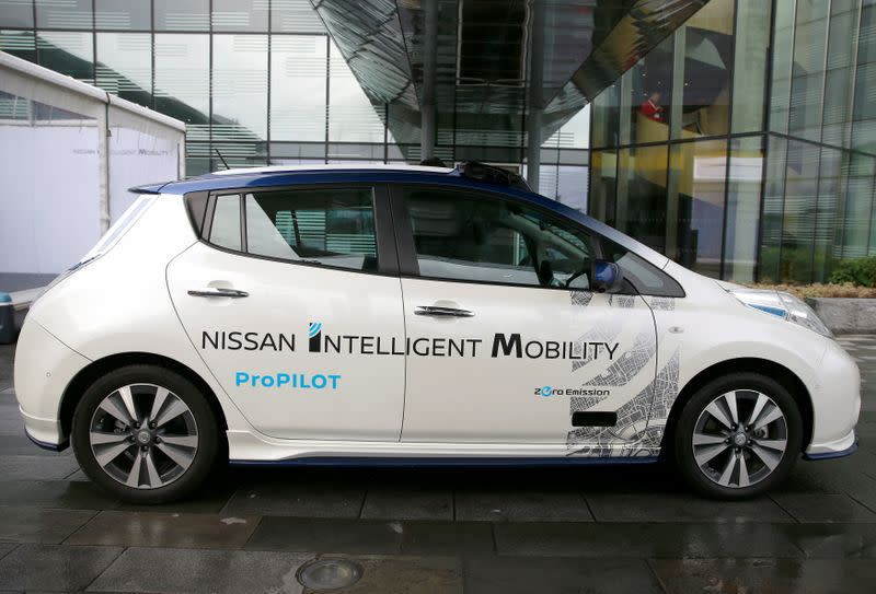 FILE PHOTO: A modified Nissan Leaf, driverless car, is seen during a pause in its first demonstration on public roads in Europe, in London