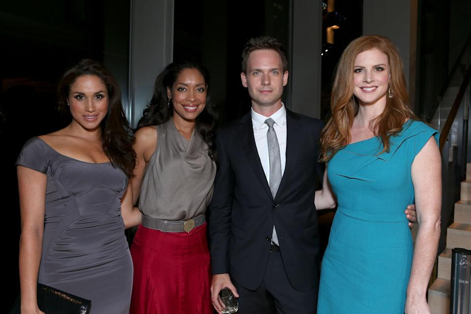 Meghan with her Suits co-stars in Toronto, in 2012 [Photo: Getty]