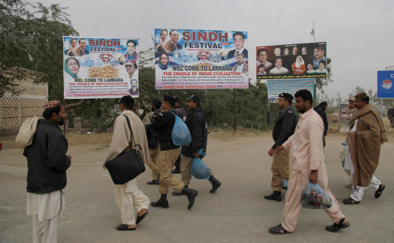 Pakistani police officers arrive to take up security duty for a grand cultural festival at the ruins of Mohenjodaro, listed on UNESCO's list of world heritage sites, near Larkana, some 400 kilometers ( 248 miles) from north of the Pakistani port city Karachi, Saturday, Feb. 1, 2014. The event at Mohenjodaro, whose unbaked brick ruins date to the 3rd millennium BC, has however drawn criticism from some archaeologists who say it poses a risk to the monuments. Bilawal Bhutto Zardari, the son of assassinated Pakistani Prime Minister Benazir Bhutto, organized the Festival aimed at promoting peace in this Islamic nation, where militant violence has killed over 40,000 people in recent years, organizers said. (AP Photo/Shakil Adil)